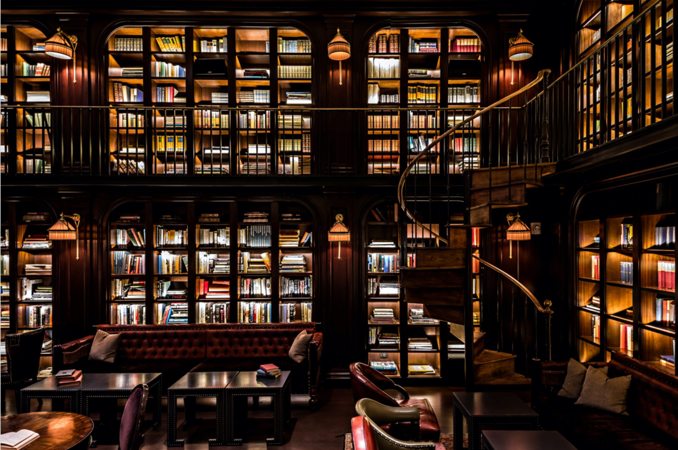 Library room with dimmed lighting and spiral staircase